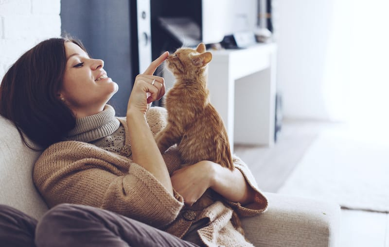 woman sitting with her cat