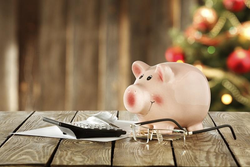 Piggy bank next to a calculator