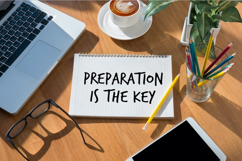 Notebook on a table that says preparation is key