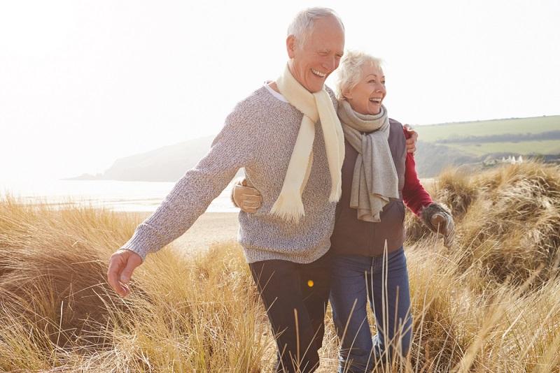 Happy older couple outside walking