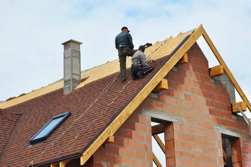 roof being installed by two men