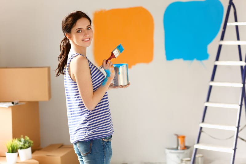 woman painting a home