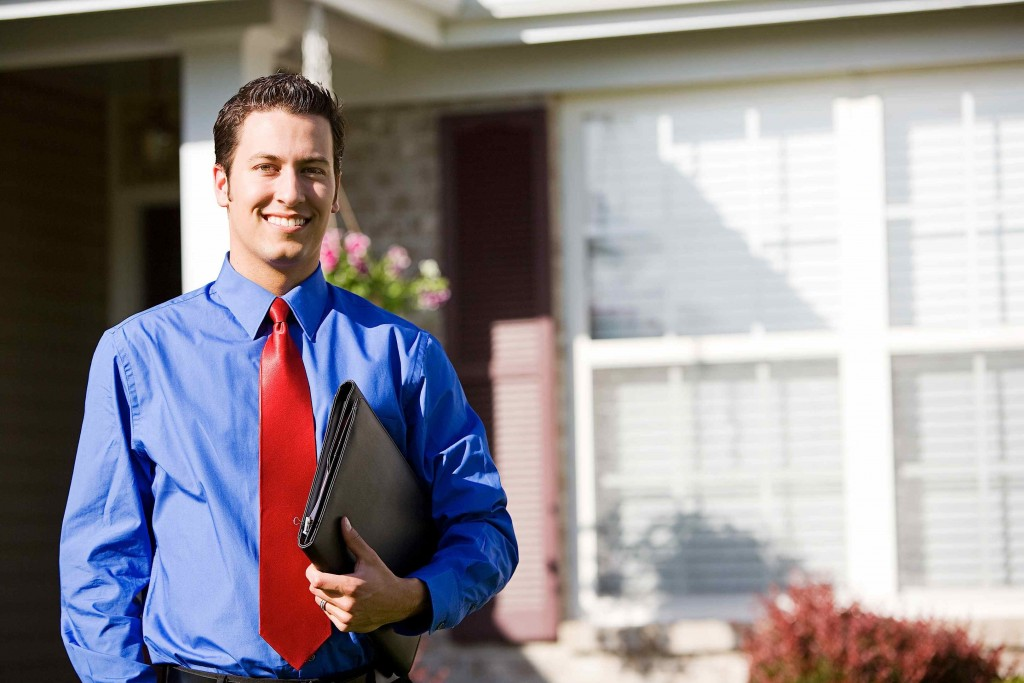 real estate agent in front of a home