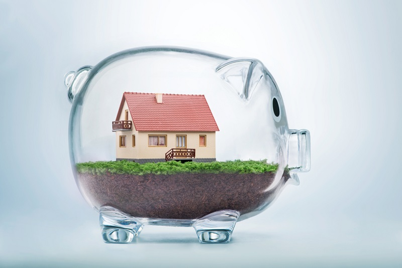Piggy bank with a house inside of it