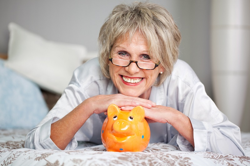 Older woman with a piggy bank