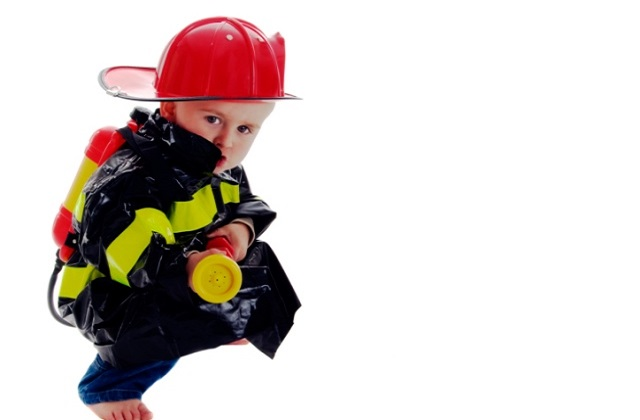 toddler wearing fire fighter costume