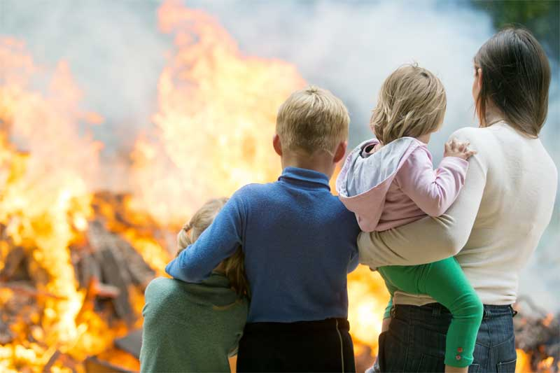 family looking at a fire burning