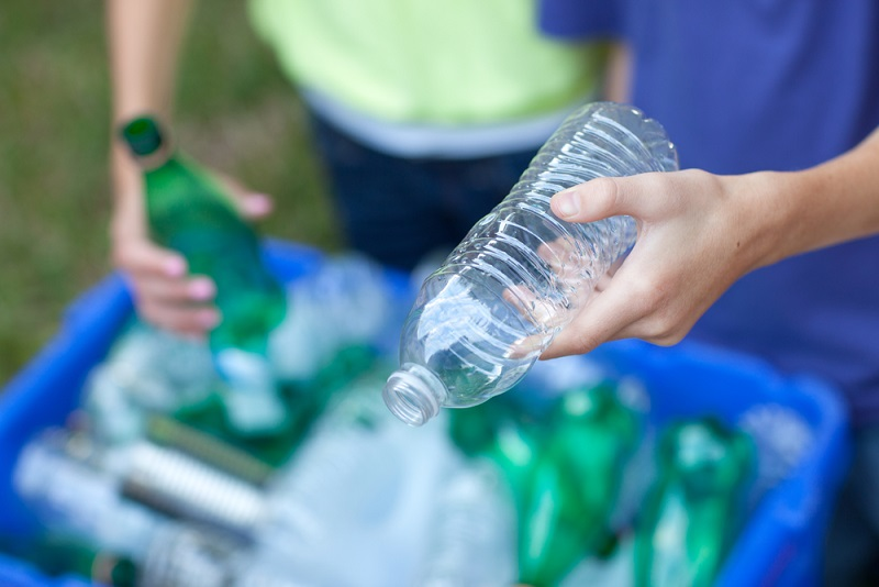 plastic bottle being recycled