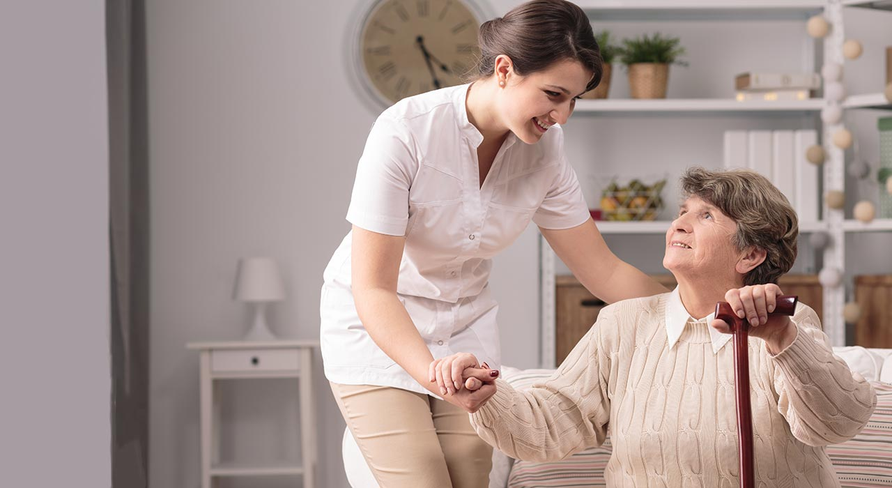 Caregiver looking at older woman