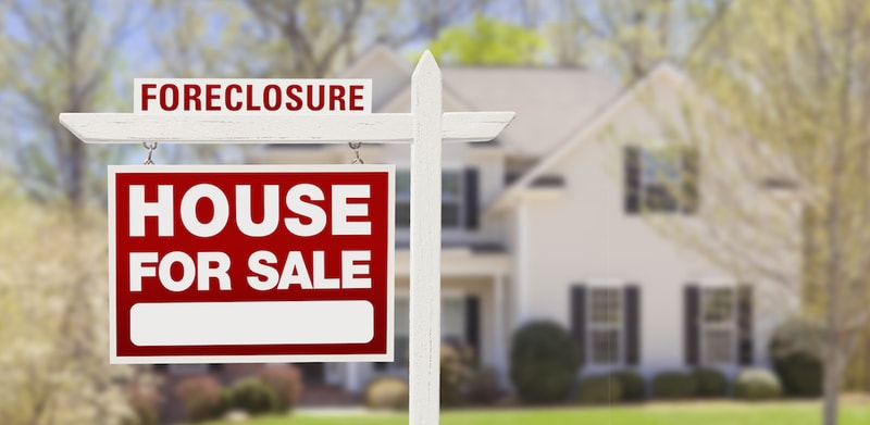 Foreclosure sale sign outside a house