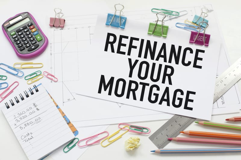 "The text ""Refinance your mortgage"" on a paper"