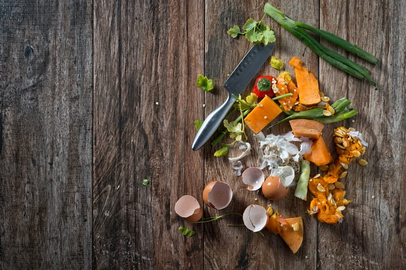 food waste on wooden background