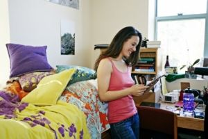 girl standing in dorm room