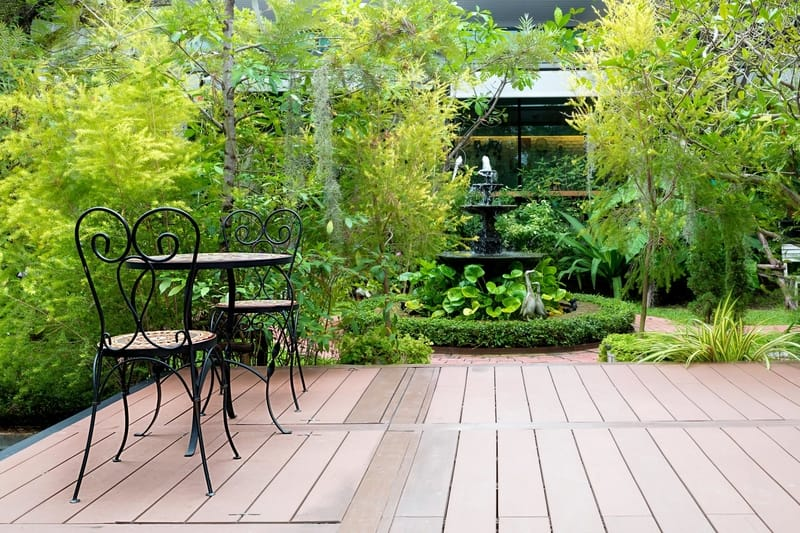 patio surrounded by plants and trees