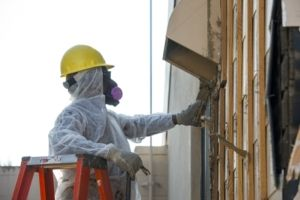 contractor wearing full protective gear