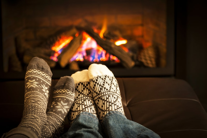 feet in front of the fireplace