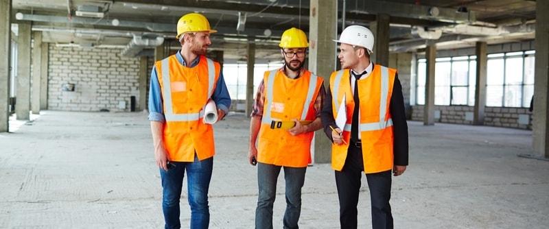 3 contractors talking