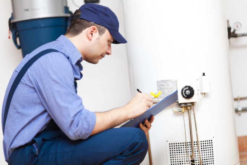 pro looking at a water heater