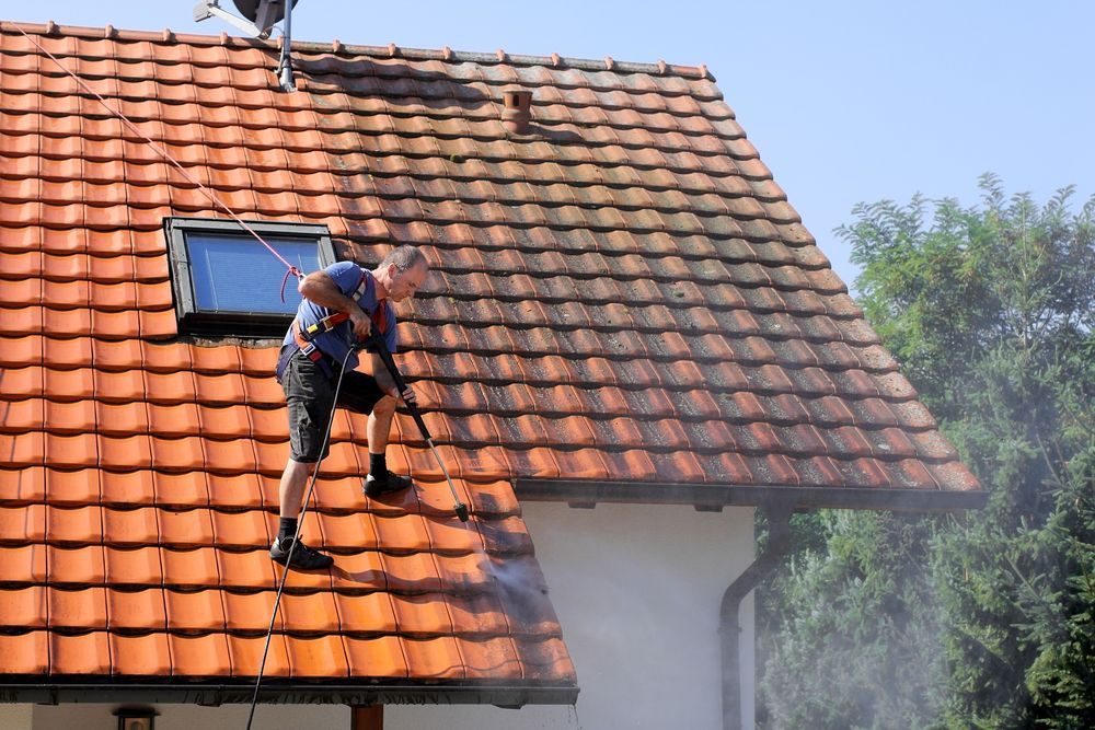 roof being cleaned