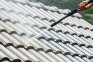 roof being pressure washed
