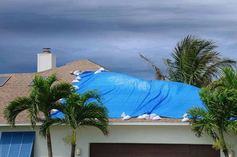 How To Put A Temporary Tarp On A Leaking Roof Amp Cost Quotes