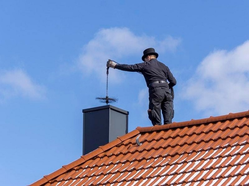 chimney being cleaned